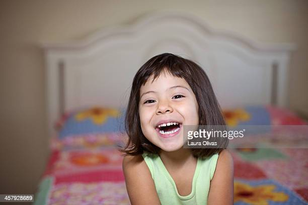 Girl Smiling on Her Bed