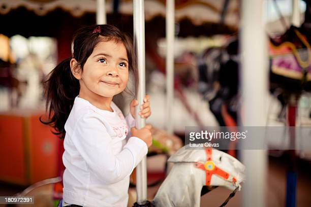 Girl Smiling On Merry-Go-Round