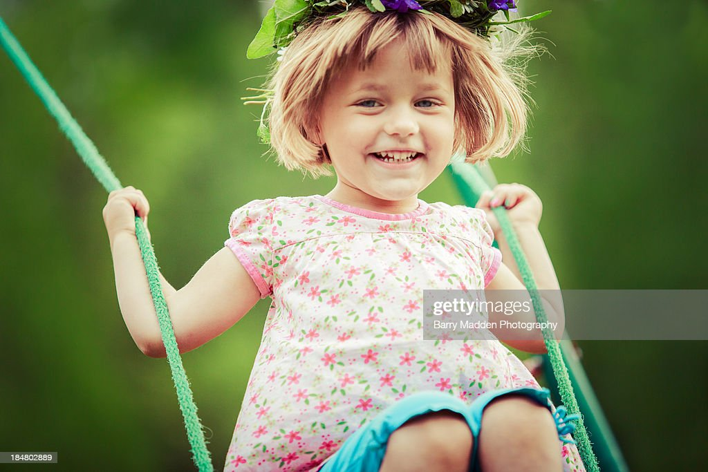 Girl smiling on swing : Stock Photo
