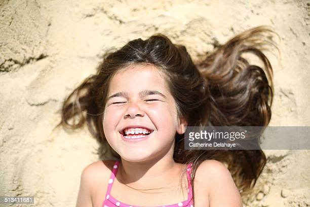 A girl smiling on the beach