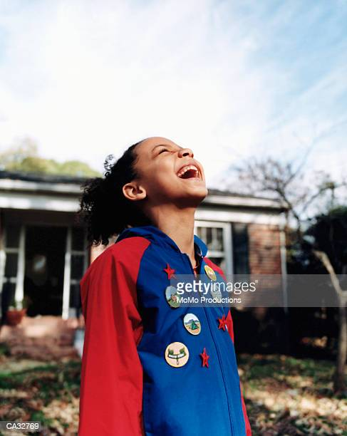 girl (6-8) smiling outdoors wearing badges on jacket - jacket stock pictures, royalty-free photos & images