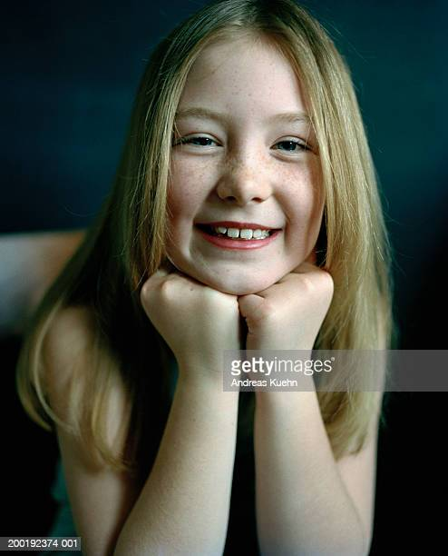 Girl (8-10) smiling, portrait, close-up