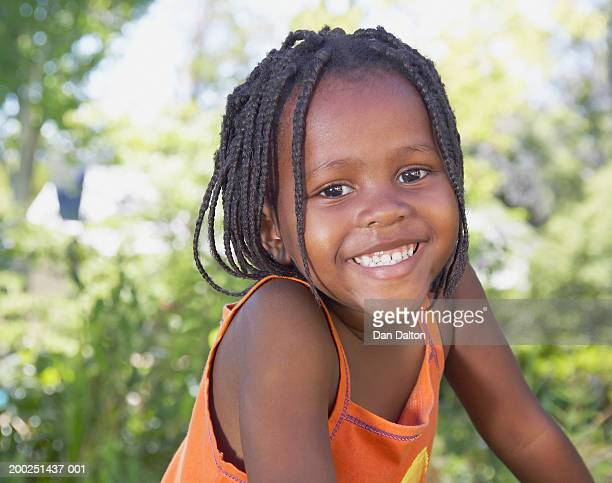 Girl (3-5) smiling, portrait, close-up