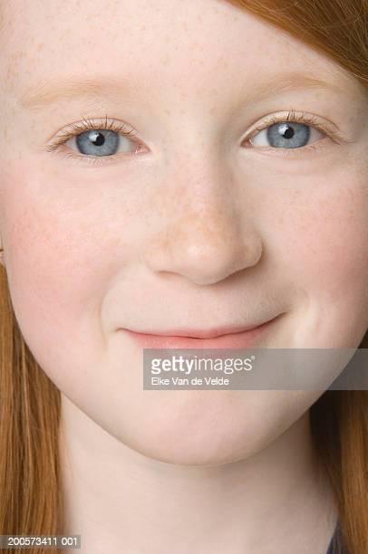 Girl (8-9) smiling, portrait, close-up