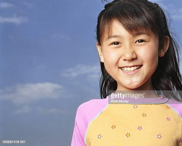 Girl (8-10) smiling, portrait