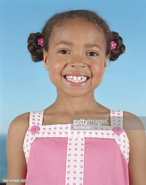 Girl (8-10) smiling, portrait