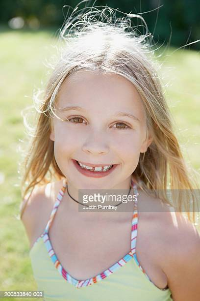 Girl (10-12) smiling, portrait