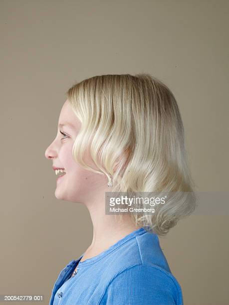 Girl (7-9) smiling, side view
