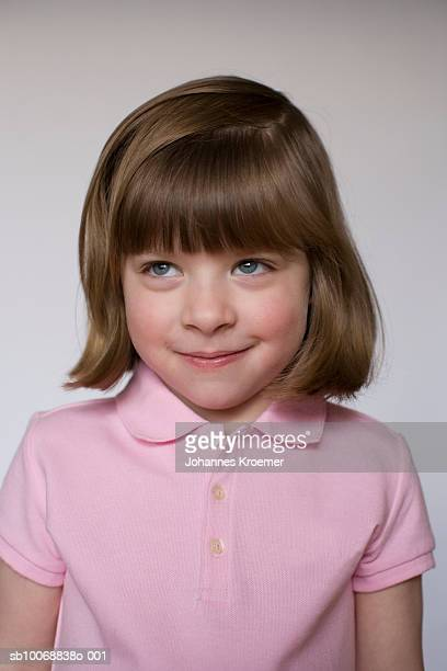 girl (2-3) smiling, studio shot - rosy cheeks stock pictures, royalty-free photos & images