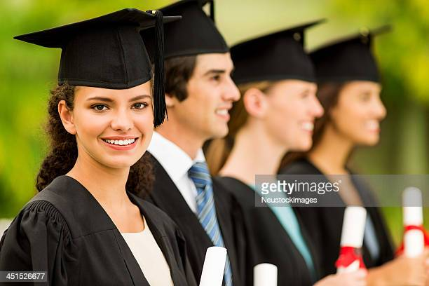 Girl Smiling While Students Standing In A Row At College
