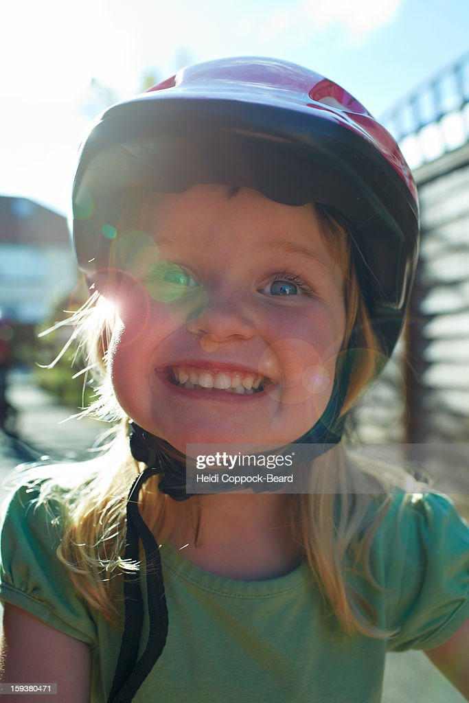 Girl smiling with bicycle helmet on : Stock Photo