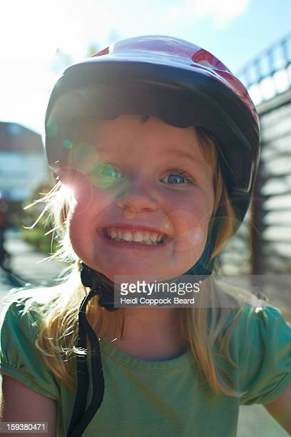 girl smiling with bicycle helmet on - heidi coppock beard stockfoto's en -beelden