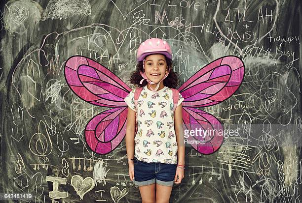 Girl smiling with imaginary wings