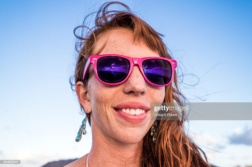 Girl Smiling with Pink Sunglasses : Stock Photo