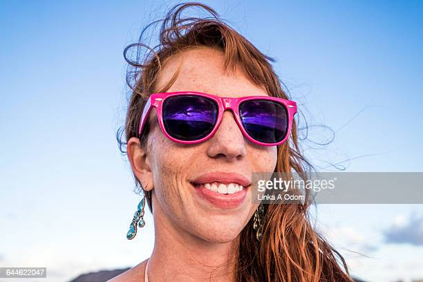Girl Smiling with Pink Sunglasses