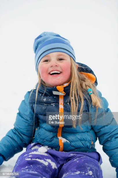 Girl smiling with snow in the face