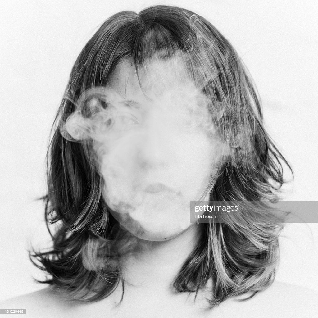 Girl smoking : Stock Photo