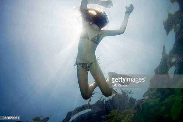 girl snorkeling in tropical waters - very young thai girls stock photos and pictures