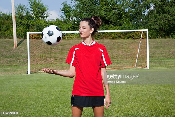 girl soccer player with ball - football strip stock pictures, royalty-free photos & images