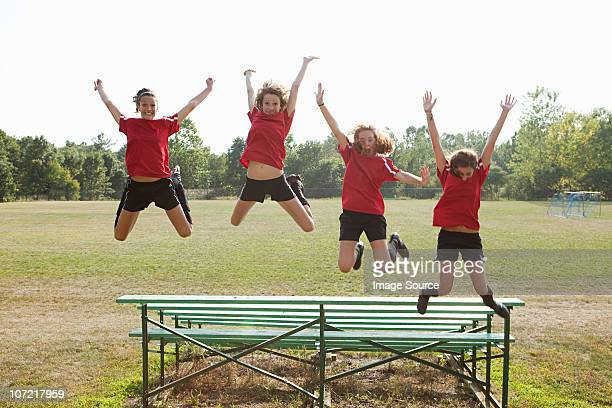 girl soccer players jumping off bleachers - chatham new york state stock pictures, royalty-free photos & images