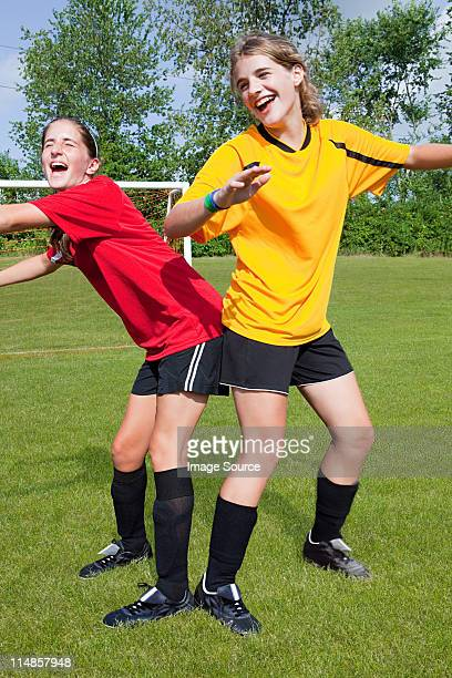 girl soccer players messing around - teen ass stock photos and pictures