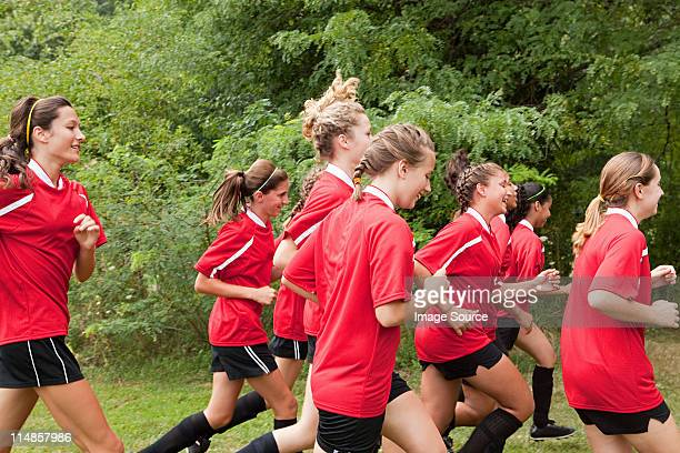 girl soccer players running - chatham new york state stock pictures, royalty-free photos & images