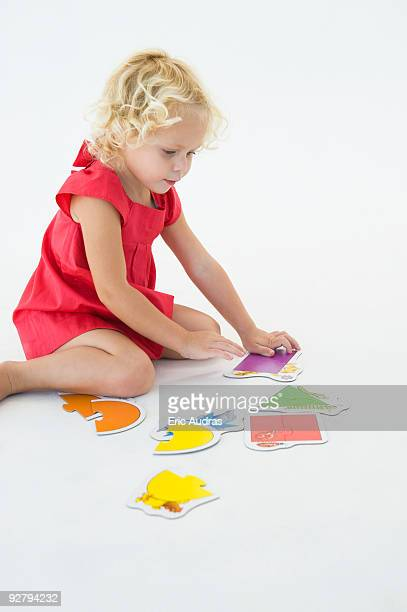 Girl solving a jigsaw puzzle