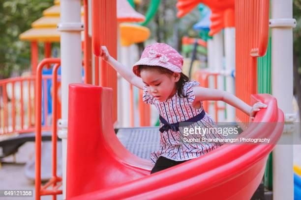 Girl speeding down the slide