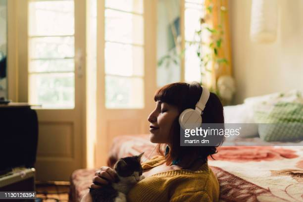 girl spending the weekend at home - listening stock pictures, royalty-free photos & images