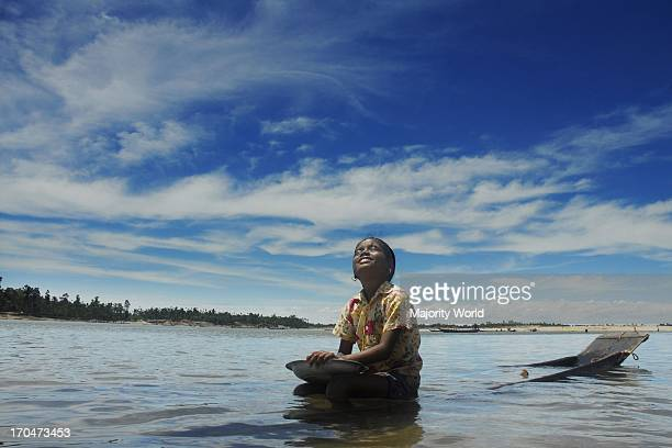 A girl spends a quiet moment on the river in Jaflong Sylhet Bangladesh August 2007