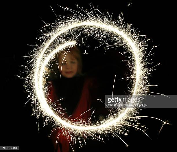 girl spinning firework sparklers - spinning stock pictures, royalty-free photos & images