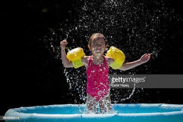 girl splashing at wadding pool