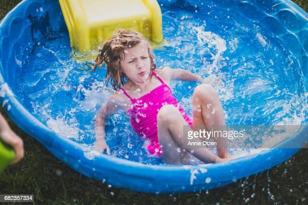 Girl Splashing into Kiddy Pool
