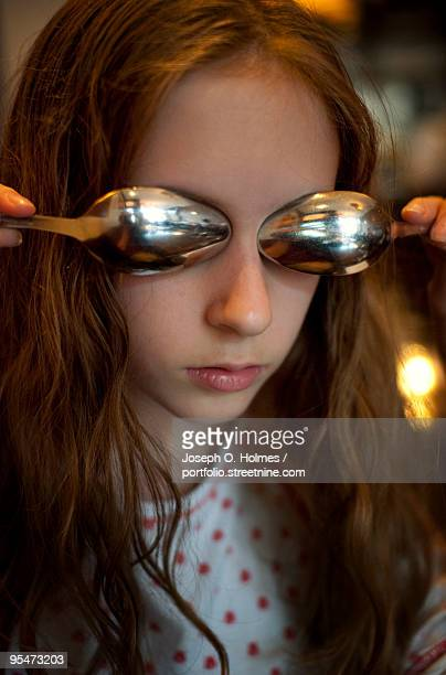 a girl spoon eyes - joseph o. holmes stock pictures, royalty-free photos & images