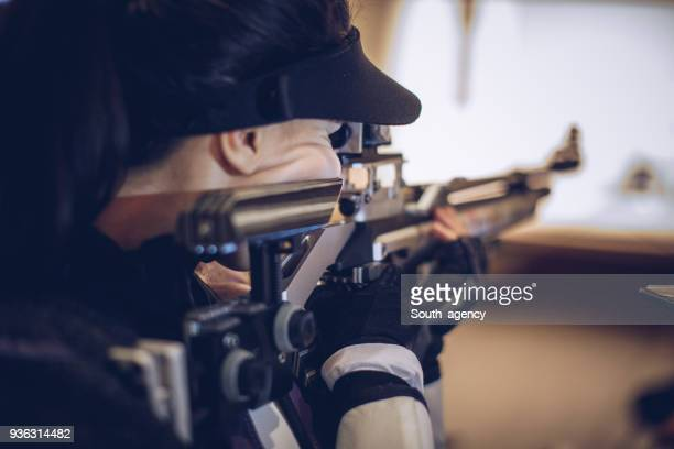girl sport shooter training - rifle stock pictures, royalty-free photos & images