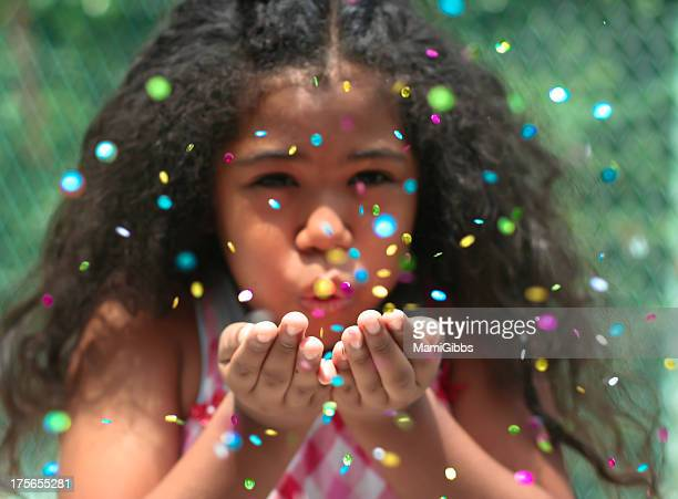 Girl spreading many color spangles