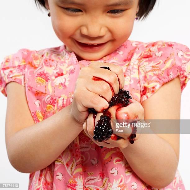 Girl Squashing Blackberries