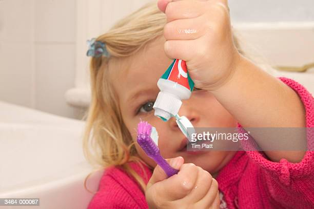 Girl Squeezing Toothpaste