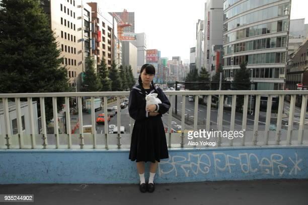 a girl stand  alone - 歩道橋 ストックフォトと画像