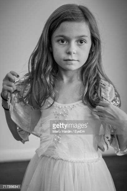 girl standing against wall at home - marty hardin stock pictures, royalty-free photos & images