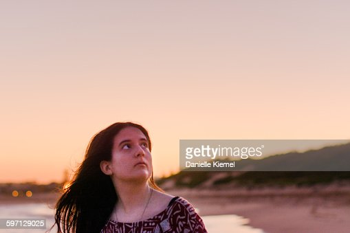 Girl Standing Alone On Beach At Sunset Front View High-Res Stock Photo - Getty Images-5598