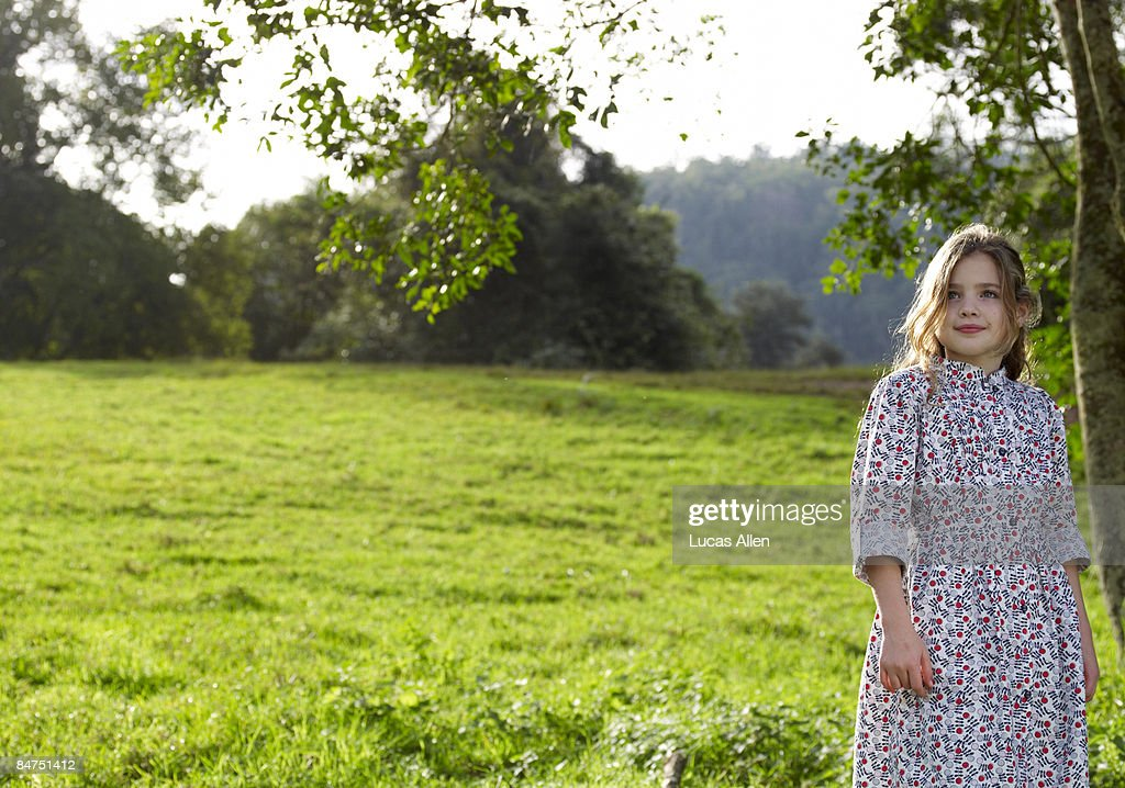 Girl Standing Alone Outdoors In Green Field Stock Photo  Getty Images-4682