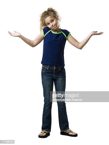 Girl standing and shrugging