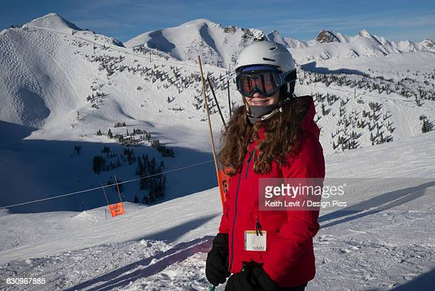 Girl standing at a ski resort with the Canadian rocky mountains in the background, Banff National Park