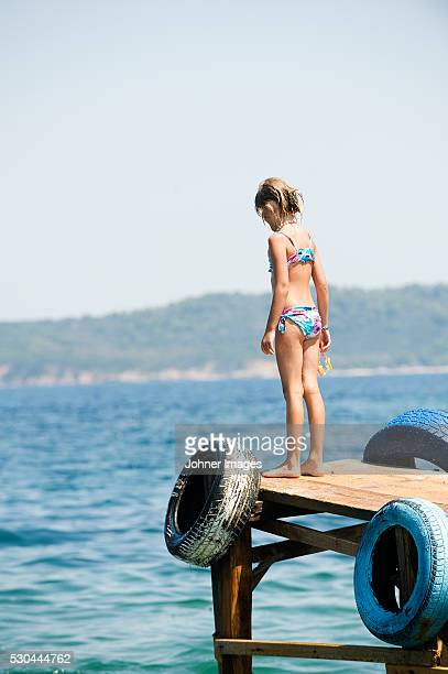 Girl standing at jetty
