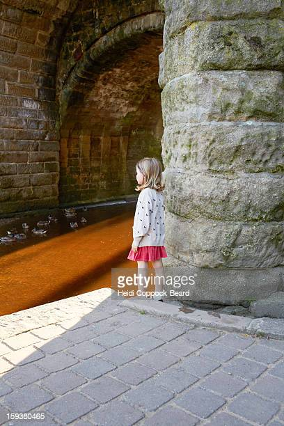 Girl standing by a river