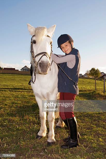 girl (10-12) standing by pony, portrait - riding hat stock pictures, royalty-free photos & images
