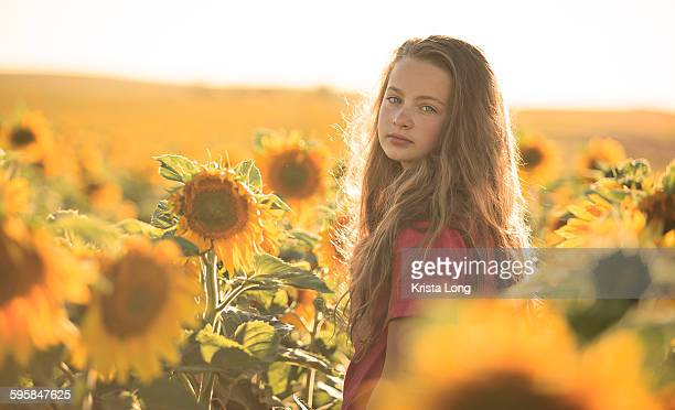 Girl standing in a sunflower field
