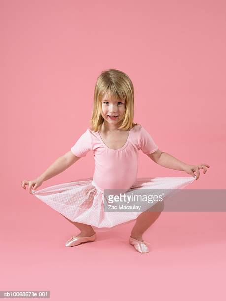 girl (4-5 years) standing in ballet pose, portrait, studio shot - 4 5 years photos stock pictures, royalty-free photos & images