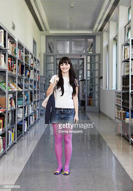 girl standing in corridor of school - mini skirt stockings stock pictures, royalty-free photos & images